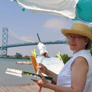 Elizabeth painting on the Detroit River, the famous US/Canadian Ambassador Bridge in the Background
